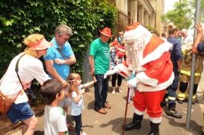 Santa meeting children
